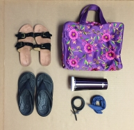 Suede Birkenstocks-style sandals from Nine West -$6 Flip flops from Crocs - $2 Travel Bag from Neiman Marcus Collection - $2 Thermos travel mug - $5 Black belt - $2 Denim headband - $2